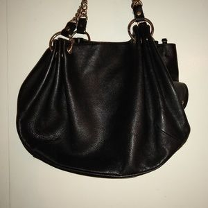 Juice Couture slouchy leather shoulder bag.